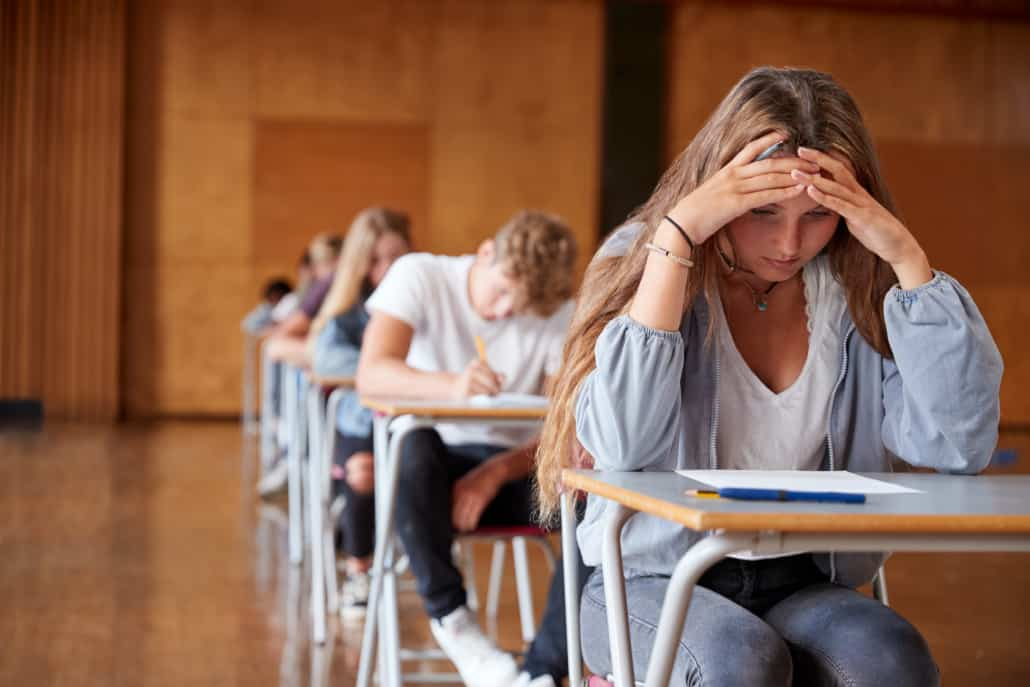 Students sitting in class and stressed